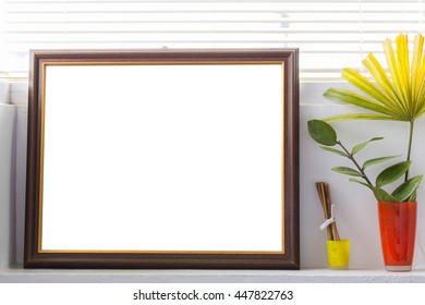 Empty picture frames, flower vases, bright colors.