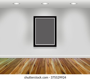 Empty picture frames hanging on the wall in a room with light.