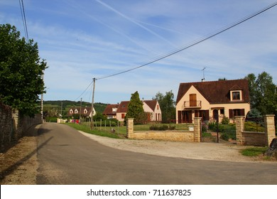 Empty picturesque street with stone houses of the village Pontaubert (department of Yonne in region Bourgogne-Franche-Comté; north-central France). Concept: traditional French regional architecture