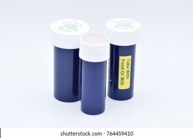 Empty Pill Bottles on White