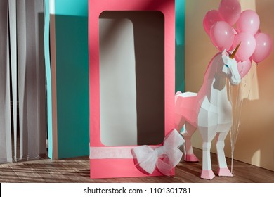 empty pink decorative box with bow and unicorn with pink balloons
