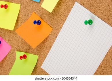Empty pinned notes on corkboard (bulletin board)