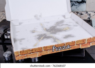Empty pizza box with grease stains, a  fast food concept