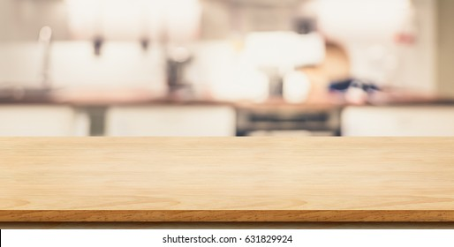 Empty plank wooden table top with blurred home kitchen,Mock up template for display or montage of your design,Banner for advertise of product,panorama view
