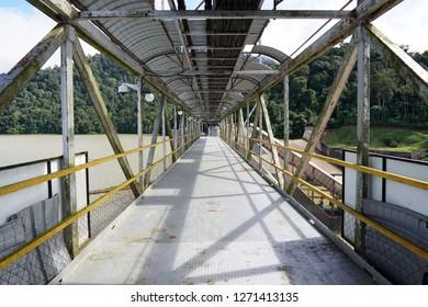 Empty plant worker walkway on a yellow steel bridge.Vintage and rustic walkway.Old steel walkway design for plant worker - Image