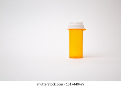 Empty plastic amber prescription medicine bottle isolated on white background