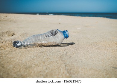 Empty plastic bottle dumped on the beach
