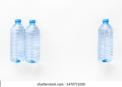 empty plastic bottles for pure water on white background top view mock up