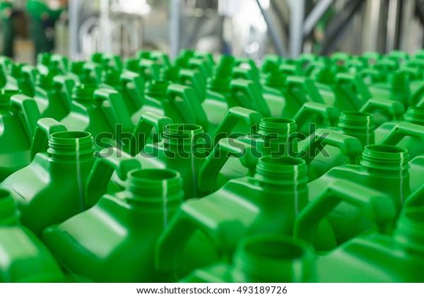 Empty plastic cans green colour for liquids. Concept: Manufacturing