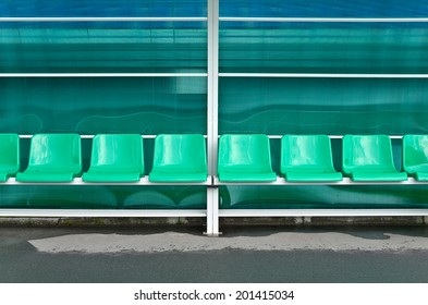 Empty plastic chairs for sports staff at the grandstand stadium