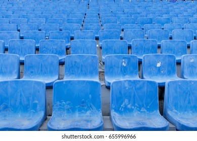 Empty Plastic Chairs at the Stadium. Blue rows of seats on the stadium