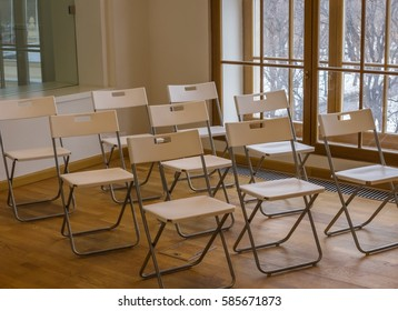 Empty plastic folding chairs in lecture hall