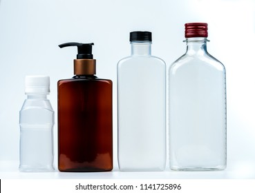 Empty plastic and glass bottle with cap and pump with black label isolated on white background. Pharmaceutical products bottle packaging.