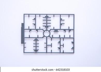 empty plastic model toy mold set on white background