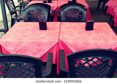 empty plastic tables of a bar restaurant