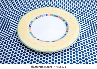 Empty plat on table caver by blue tablecloth