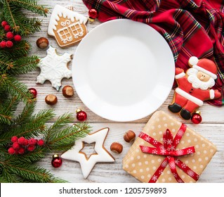 Empty plate with Christmas cookies and Christmas tree on a old wooden table