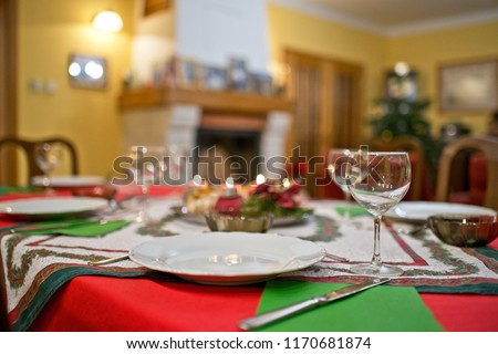 Empty plate with cutlery on the Christmas table.