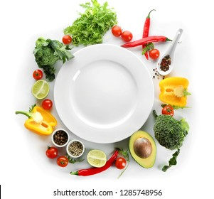 Empty plate and different products on white background