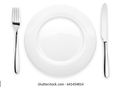 Empty plate, fork, knife,white background, isolated, top view from first person
