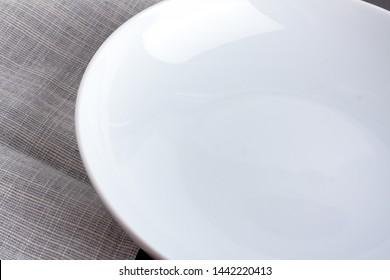Empty plate with grey napkin.