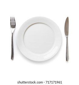 Empty plate with knife and fork isolated on white