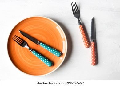 empty plate and knife,fork on a white wooden background