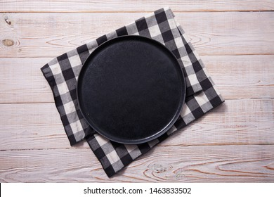 Empty plate and napkin on white wooden table. Empty tray. Mockup for design. Top view.