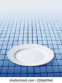 Empty plate on a blue  background