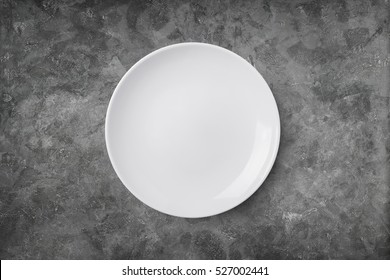 Empty plate on cement background. Top view with clipping path