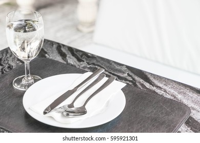 empty plate on dinning table with glass