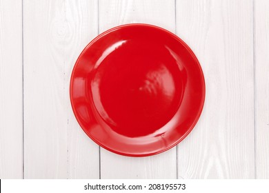 Empty plate on white wood