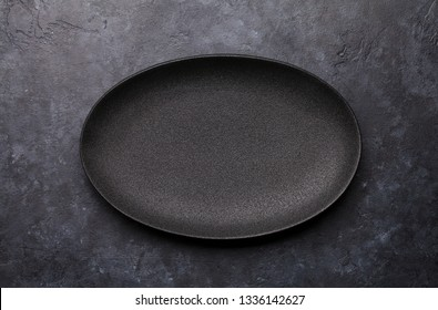 Empty plate over kitchen table. Food cooking template concept. Top view with copy space. Flat lay