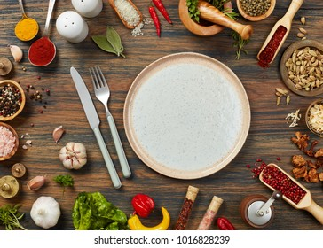 Empty plate, silverware and ingredients
