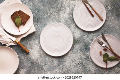 Empty plate white linen napkin two empty plates overhead ceramics copy space text