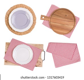 Empty plates and cutting board on napkins, isolated on white background