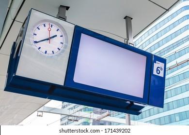 Empty platform information display with clock on a Dutch railway station