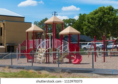 an empty playscape in the middle of a hot Texas afternoon