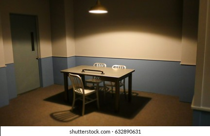 EMPTY POLICE INTERROGATION ROOM.
