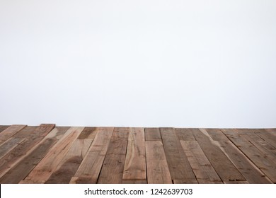 Empty portrait background with a wood board floor and white wall backdrop