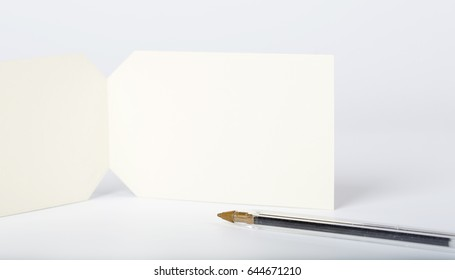 Empty post card with a black pen. Free space for a text