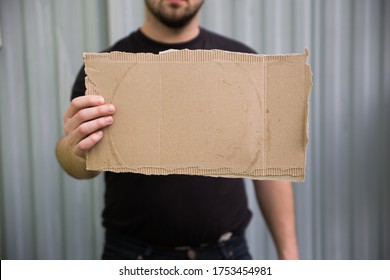 Empty protest cardboard in hand