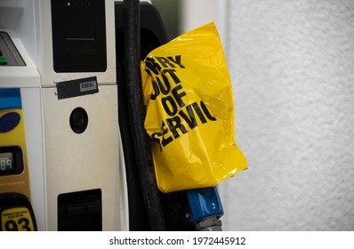 An empty pump at a gas station is covered with a yellow plastic bag following a cyber attack on the Colonial Pipeline.