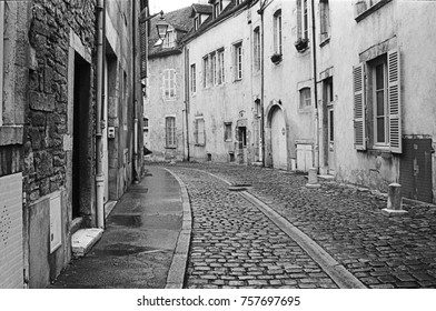 An empty, quiet street in Beaune during the middle of the day shows the character of the old city. (Scanned from black and white film.)
