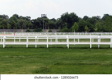 Empty racing track racecourse without horses and riders