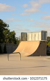 Empty ramp at skatepark on a summer morning background.