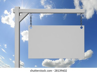 Empty real estate sign with sunny sky background