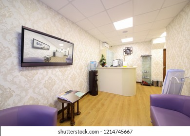 Empty reception and rest room with sofas, tv in medical center