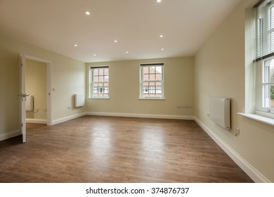 Empty reception room within brand new first floor apartment with dual aspect windows