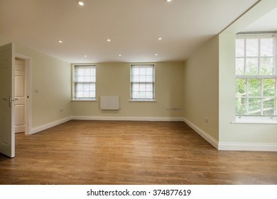 Empty reception room within new home with windows to two aspects